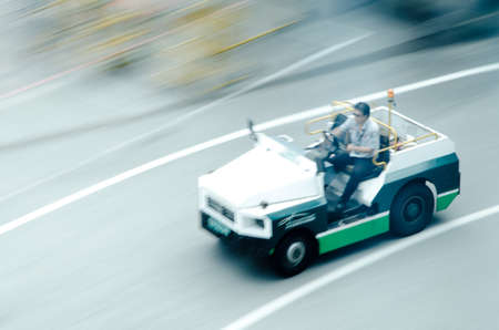 car carrier: cargo car delivery on airport blur motion