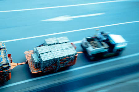 land transportation: cargo car delivery on airport blur motion