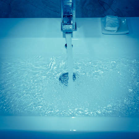 modern wash basin with running water Stock Photo - 10784670