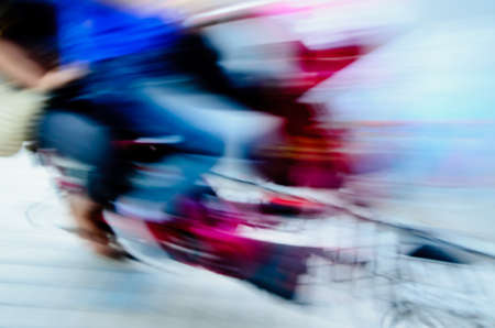 abstract big city motor bicycle driver blur motion photo