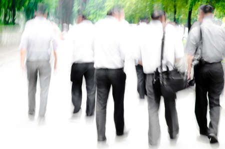 leaving: walking business people abstract background blur motion Stock Photo