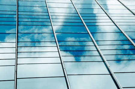 modern big city glass office building with clouds and sky photo