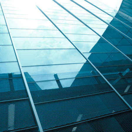 angle views: modern big city glass office building with clouds and sky
