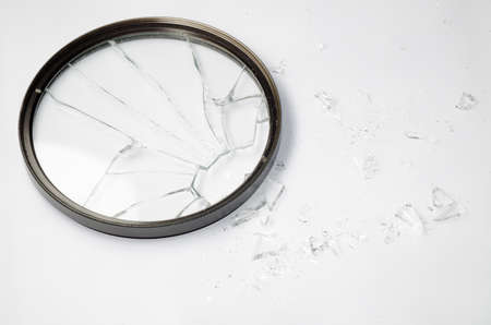 broken Dslr lens UV filter isolated on white photo