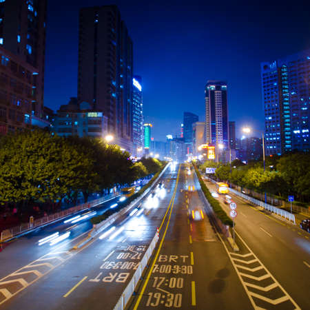 busy big city night traffic blur motion in Guangzhou China photo
