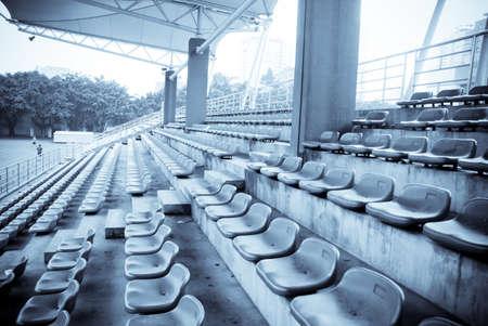field event: sports stadium with empty seats row Stock Photo