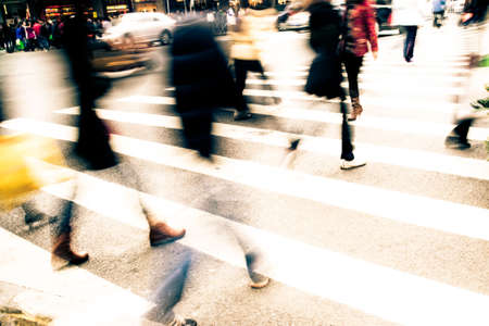 Busy big city street people on zebra crossing photo