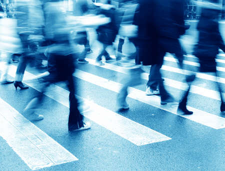 action blur: people on zebra crossing street