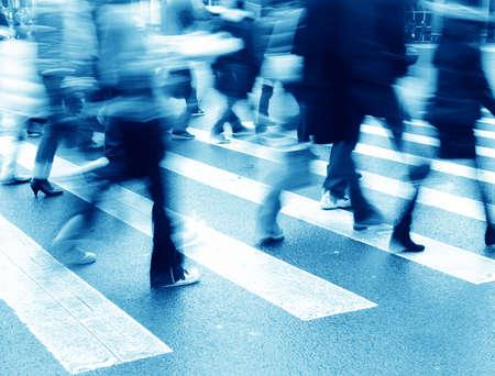 action blur: people on zebra crossing street