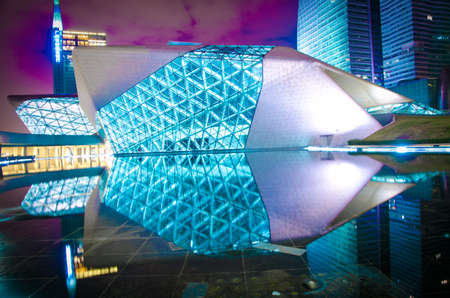 become: Guangzhou, China - Nov. 05: Guangzhou Opera House night  landscape on Nov. 05, 2011 in Guangzhou, China. It is designed by architect Zaha Hadid and has become one of the seven new landmarks in Guangzhou