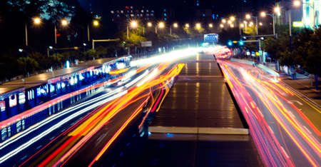busy big city traffic trail night cityscape at Guangzhou China photo