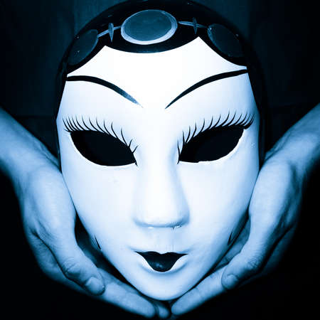 Chinese ancient opera mask in hand photo