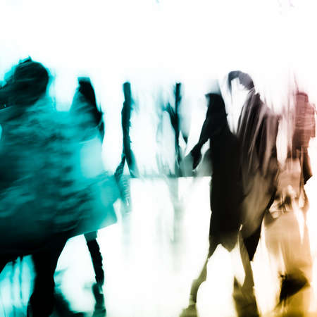 street life: city business people abstract background blur motion