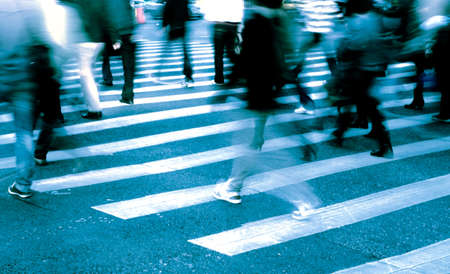 busy city people crowd on zebra crossing street photo