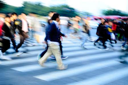 pedestrian: busy city people crowd on zebra crossing street