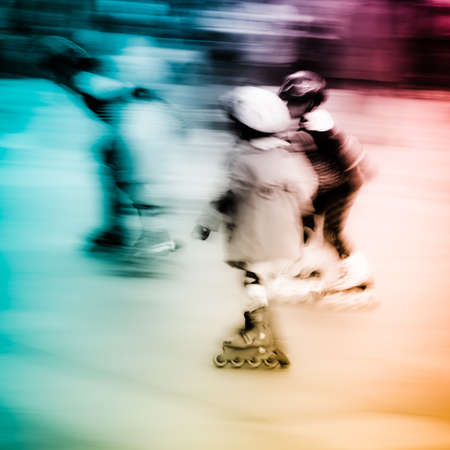 rollerskating: child playing rollerblade blur motion Stock Photo