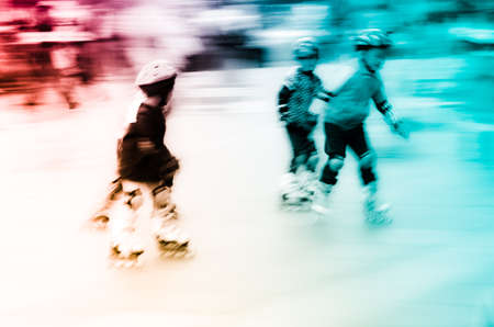 rollerblade: child playing rollerblade blur motion Stock Photo