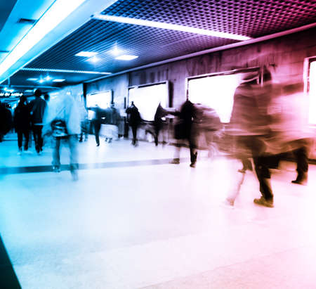 Business passenger walk at subway station at intentional motion blurred photo
