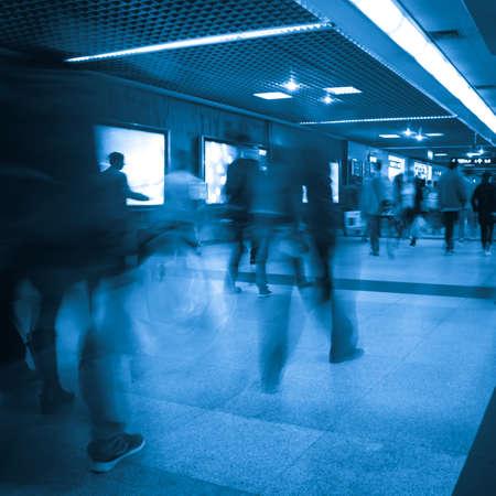subway station: Business passenger walk at subway station at intentional motion blurred
