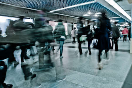 intentional: Business passenger walk at subway station at intentional motion blurred