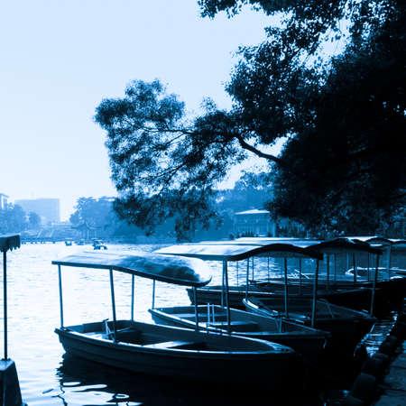 boat on lake in park photo