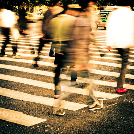 blurry: busy city people crowd on zebra crossing street