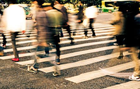 crossing street: busy city people crowd on zebra crossing street