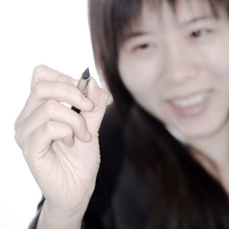 Asian business woman writing something with a pen isolated photo