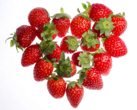 red strawberry heart shape  isolated on white photo