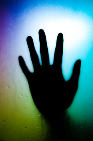 silhouette of hand with glass Stock Photo - 12396708