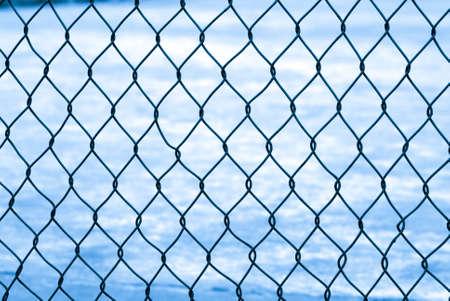 Mesh fence isolated on white photo