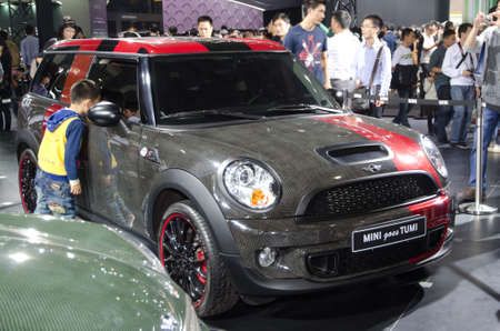 GUANGZHOU, CHINA - Nov 26: Mini goes Tumi car on display at the 9th China international automobile exhibition. on November 26, 2011 in Guangzhou China.