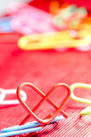 heart shape paper clip background Stock Photo - 13228438