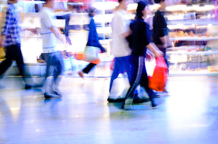 rush hour: city shopping people crowd at marketplace abstract background