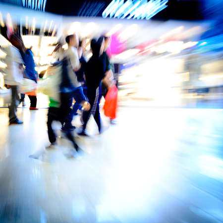 blurred people: city shopping people crowd at marketplace abstract background