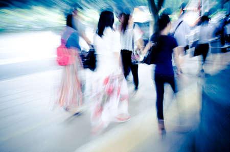 walking shopper people on the street, blur motion photo