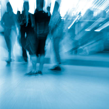 Business passenger crowd at subway station motion blurred abstract photo