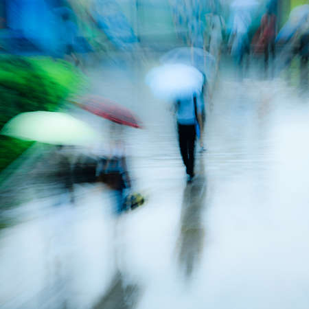big city people walk on road in rainy day, blured motion abstract background. Standard-Bild
