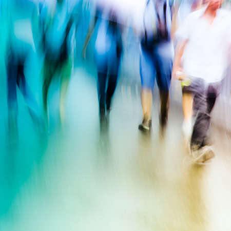 windy city: big city people walk on road in rainy day, blured motion abstract background. Stock Photo