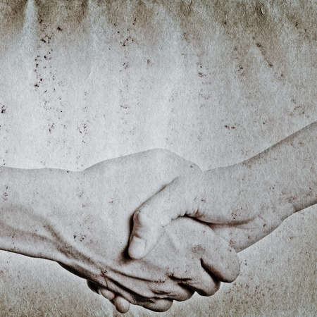 business hand shaking concept, on grunge paper background photo