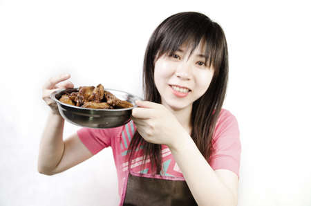 braised: chinese woman with braised chicken wing Stock Photo