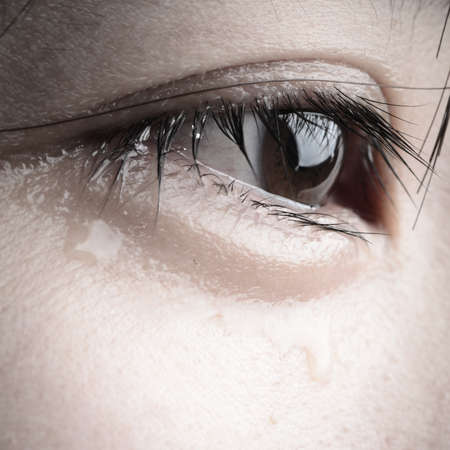 eye with tear of asian woman Stock Photo