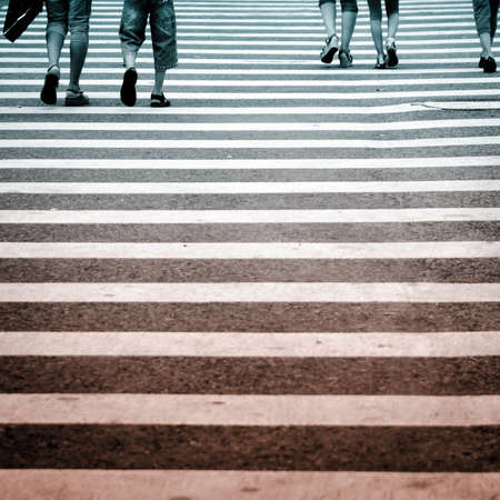 Pedestrians in modern city zebra crossing road photo