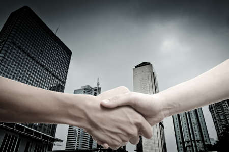 business handshake on modern city photo