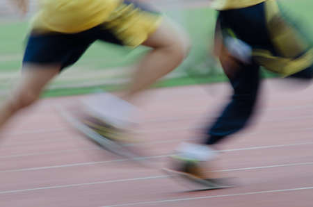 running child on sport track, blurred motion abstract background photo