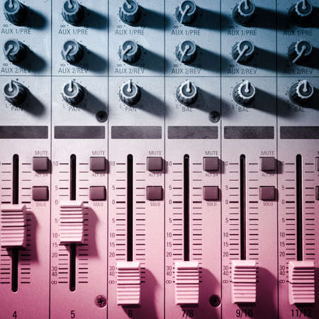 music production: sound studio adjusting record equipment