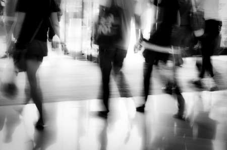business people activity standing and walking in the lobby motion blurred abstract background Stock Photo