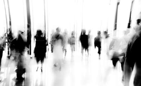large crowd of people: business people activity standing and walking in the lobby motion blurred abstract backgorund