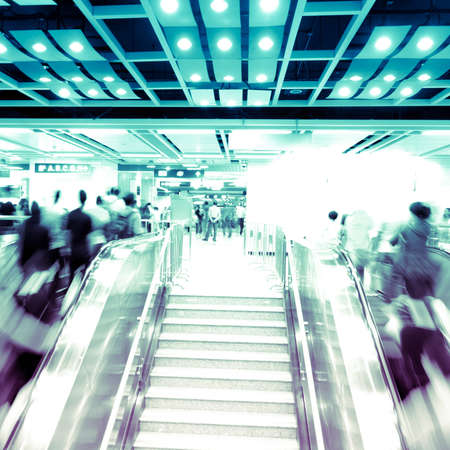 city business people on escalator abstract blur photo