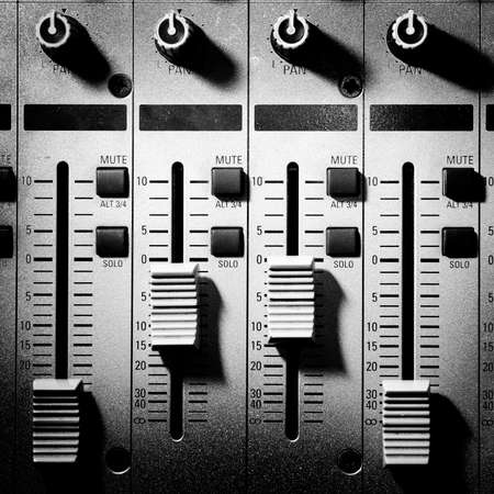 sound studio adjusting record equipment